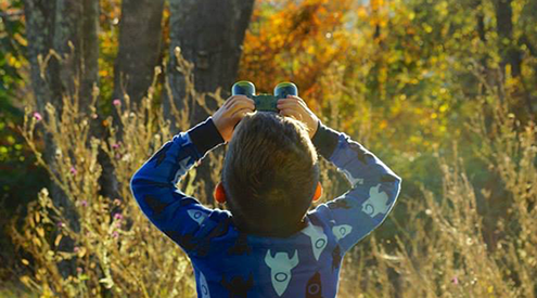 Child with binoculars, Em Sartor