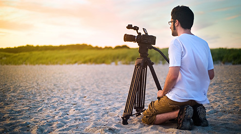 Boy on Beach with Video Camera, Shutterstock
