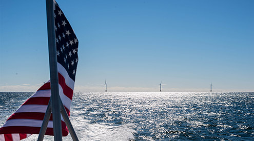 American flag and offshore wind turbines, NWF Staff