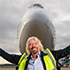 Richard Branson in front of Virgin Altantic airplane