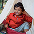 boy smiling in tent