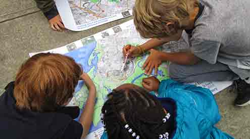Kids with forests and wetlands map