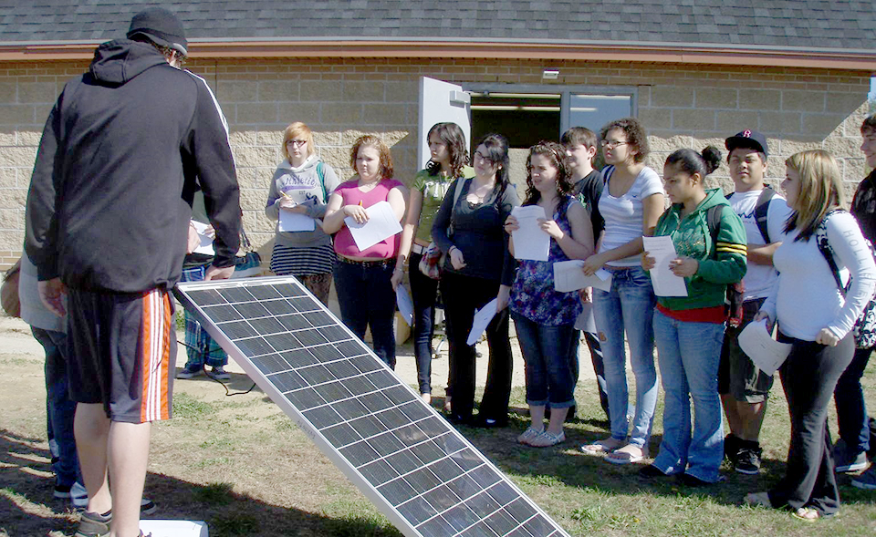 Students looking at solar panels