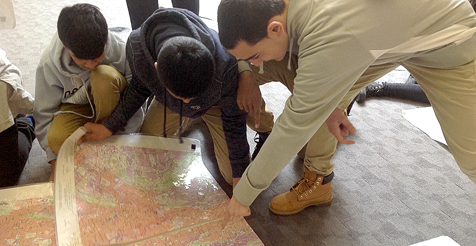 students looking at a physical map