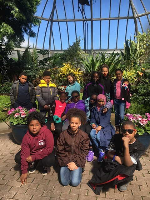 group of students in greenhouse