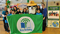 students holding eco-schools flag