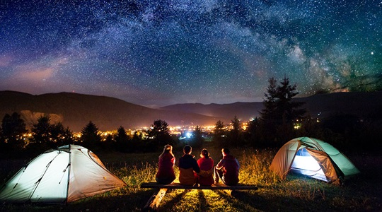 family camping under the stars