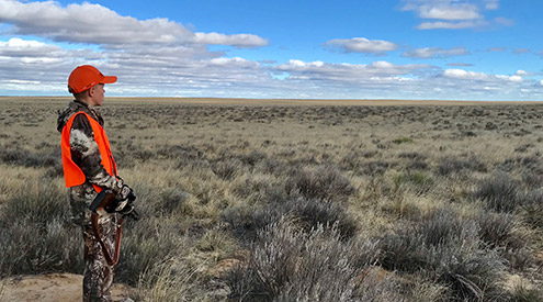 young hunter in sagebrush steppe
