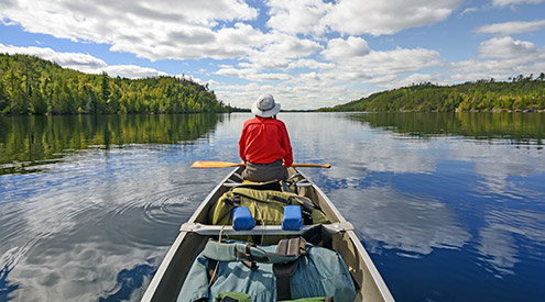 a person in a canoe in the Boundary Waters in Minnesota