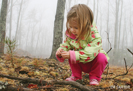 Child playing in woods near Virginia Blue Ridge Parkway