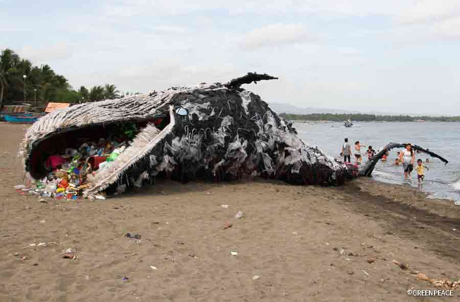 Plastic whale replica art installation depicting a dead whale choked by plastics, South of Manila. Greenpeace Philippines.