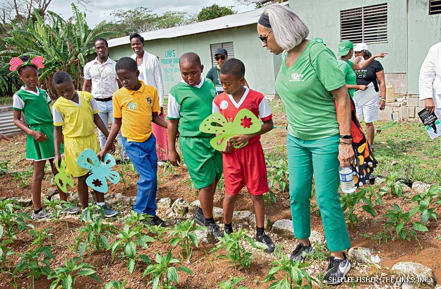 The Links' National President, Dr. Kimberly Jeffries Leonard, helping 4th grade students at St. Mary's Preparatory School outside Montego Bay,  Jamaica, plant The LInks' first certified Garden for Wildlife.