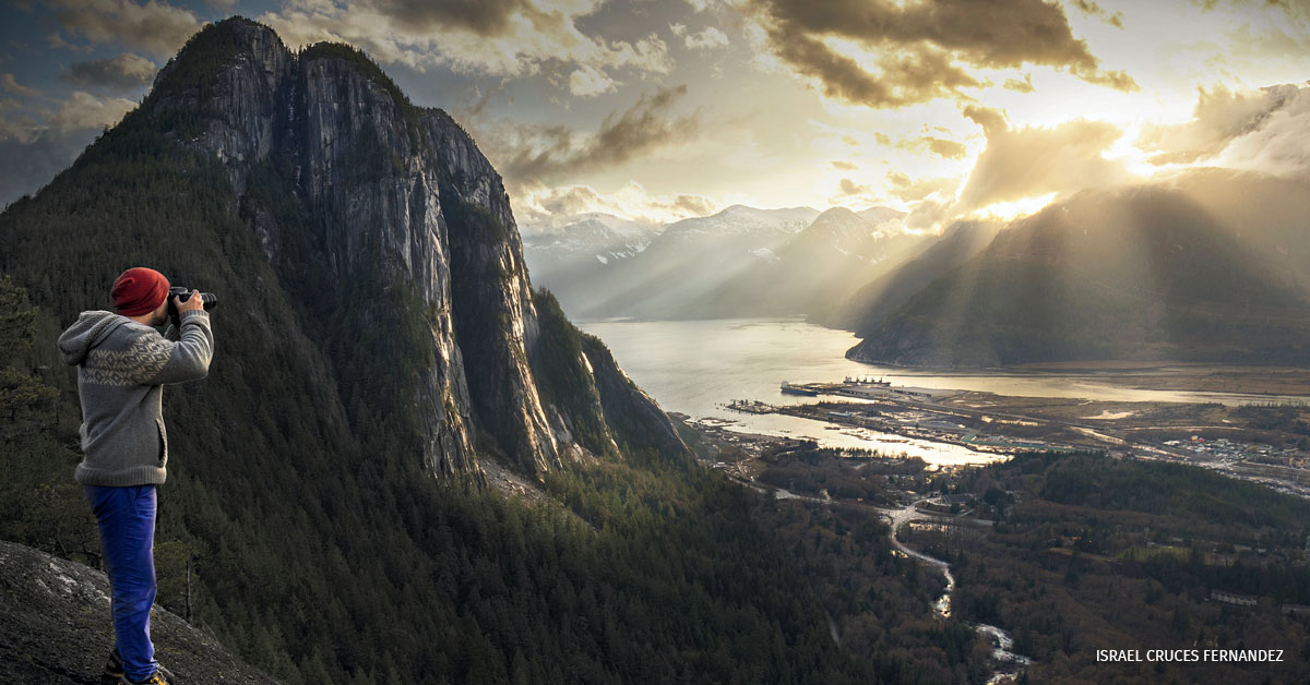 A photographer captures a sunlit landscape in Squamish, British Columbia, Canada.