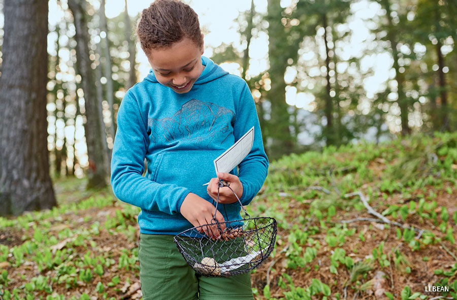 A young girl on a nature scavenger hunt