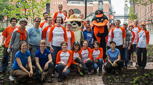 a group of gardeners with Ranger Rick and the Oriole Bird mascot